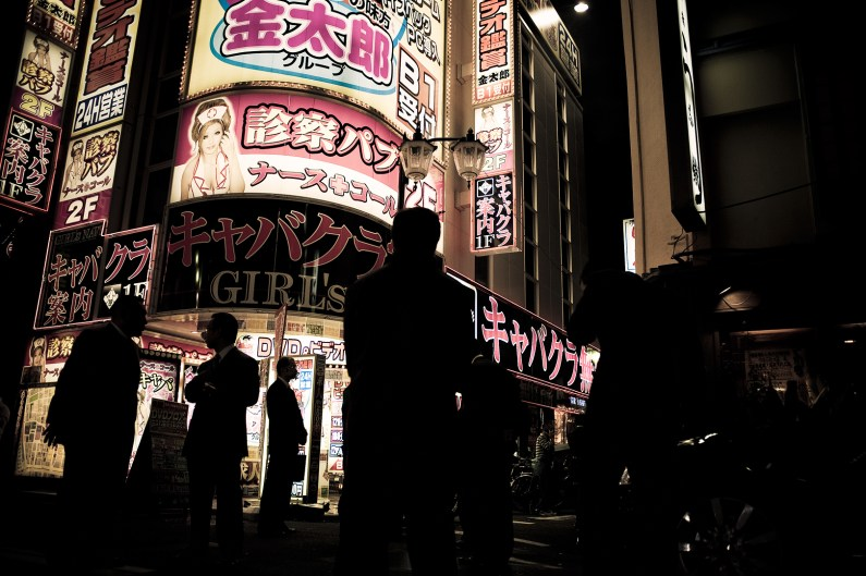 Family members meeting out on the street in front of the clubs they control in Kabukicho, Tokyo - 2009