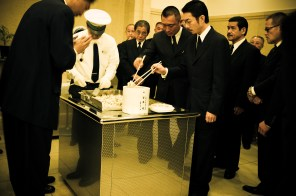 Family members picking Miyamoto-sanÕs bones and putting them in an urn, which will be presented to his close family, after the burning of his body during the traditional japanese funeral - 2010