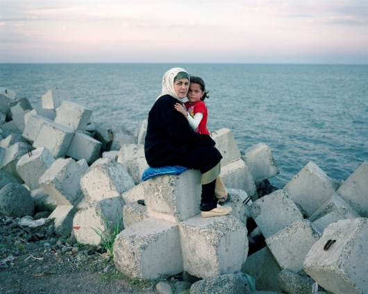A mother and daugher sit on the artifical sea wall in Astara, Azerbaijan, by the Iranian border. The Caspian's sea borders are still unresolved between Azerbaijan and Iran, almost twenty years after the dissolution of the Soviet Union. Both countries claim ownership of lucrative oil fields in the southern waters, which has led to a series of confrontations, as each side has forged exploritory missions to profit from the region.