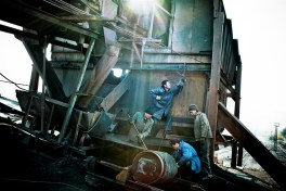 Men try to repair an old coal plant dating back from the Soviet era in Tash Kumyr.