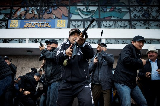 Overthrown President Kurmanbek Bakiyev's personal bodyguards shoot in the sky to calm down anti-Bakiyev supporters. This helped Bakiev to escape the city safely and fly to Kazakhstan.