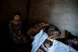 Ethnic Uzbek women and children who fled their homes in Osh and are now staying in a house close to the Uzbekistan border, to protect themselves and in the hope of crossing. Fighting between ethnic Kyrgyz and Uzbeks in southern Kyrgyzstan left, observers say, up to 2,000 people and 400,000 displaced.