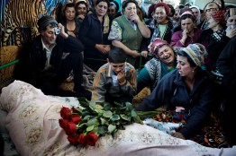 Ethnic Meskhetians mourn the death of a relative killed during ethnic clashes in the suburbs of Bishkek a week after the 7th April 2010 uprising when the government was overthrown.
