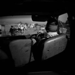 Local taxis, in the most incredible state of disrepair, ferry people within Diepsloot.