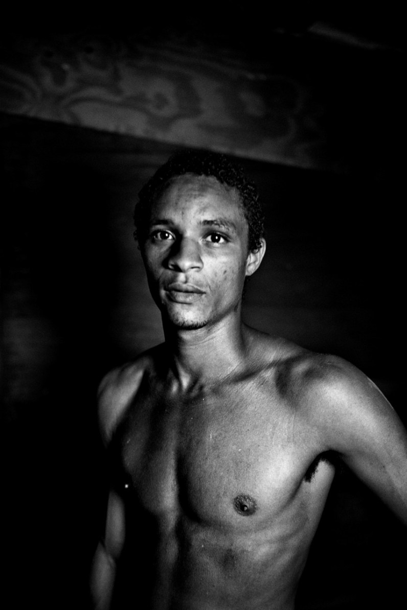 Paizinho (25) is the chief of the community inside the favela in the old chocolate factory. He solves the problems that exist between families.