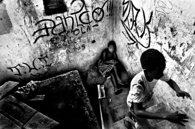 Children playing in a old chocolate factory occupied since 2003 for dozens of families. These families were looking for a decent place to live and a more prosperous future for their children, away from the dangerous streets of Salvador de Bahia in Brazil.