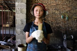 """A worker in a factory that produces chopsticks made from bamboo. """"China produces 57 billion pairs of disposable chopsticks every year, which requires over 1.18 million square meters of forest,"""" according to Greenpeace East Asia."""