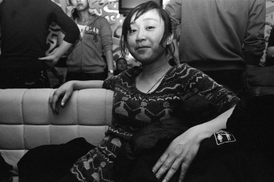 Sister Hong at a dance club in Changsha, China 2010. Changsha is famous for its nightlife and its bars and clubs attract tourists from across China looking to party hard on the cheap.
