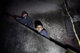 A boy Inside a building in Nasser hill.