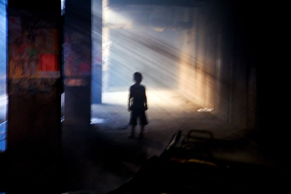 A young boy at the scene of a garbage fire in Pristina, Kosovo.