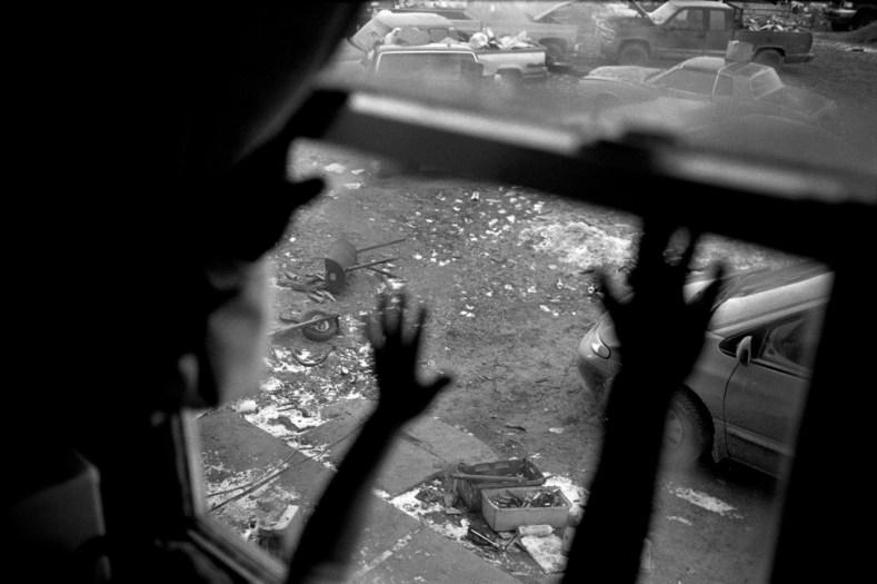 Summer Mills at her grandmotherÕs front window, Porcupine, Pine Ridge Reservation. (2010)