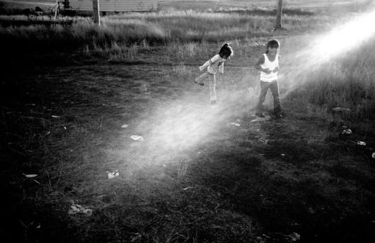 Children play at sunset, Allen, Pine Ridge Reservation. (2008)