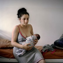 """Gayane Aghajanyan breastfeeds her newborn son Rafael at Stepanakert Maternity Hospital in Nagorno Karabakh, 2011. Gayane will receive a 1st baby payment of approximately €190 (100,000 ad) as part of the government's """"Birth Encouragement Program""""."""