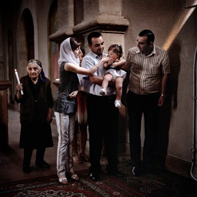 """Maria Arustamyan is christened on her first birthday at Ghazanchetsots church in Shushi. Maria's parents, Anush and Grigory (pictured with Maria's godparents and grandmother) received a wedding and 1st baby payment of approximately €765 (400,000 ad) as part of the government's """"Birth Encouragement Program"""". Nagorno Karabakh, 19th July 2011."""