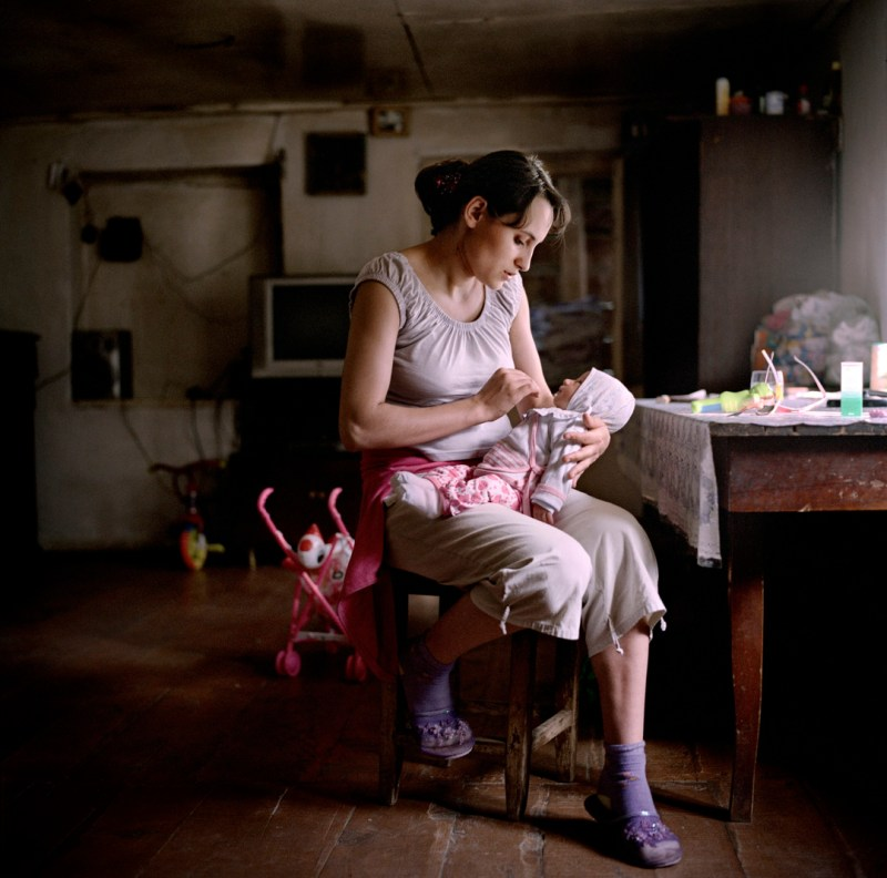 """19 year old Narine Hakobyan at home with her new born daughter Inna, in Kolatak village where she lives with her husbands family. Nagorno Karabakh, 2011. Narine and her husband Suren have received approximately €1150 (600,00 ad) in wedding and baby payments as part of the government's """"Birth Encouragement Program""""."""