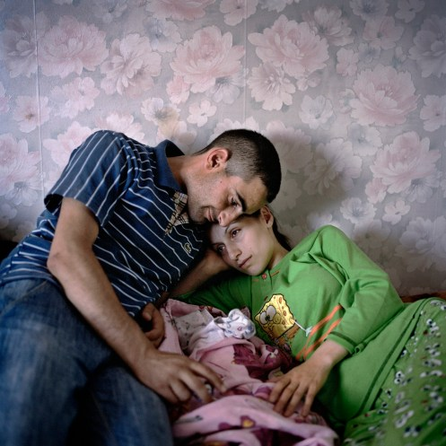 Marianna Avanesyan, 24, and her husband Sevak Gurgenyan at home with their new baby daughter Nare in Askeran, Nagorno Karabakh, 2011. Marianna and Sevak got married in the 2008 mass wedding and have so far received approximately €2800 ($4000) from the private businessmen who organised and funded the wedding, and expect a further €2100 ($3000) shortly for the birth of Nare, who is their second child and was delivered at Stepanakert Maternity Hospital on the 8th July 2011.
