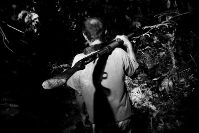 VENEZUELA, SANTA ELENA DE UAIREN. JANUARY 2010. A diamond and gold searcher carrying a shotgun.