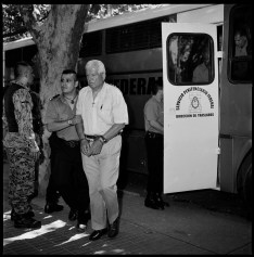 Colonel Hugo Delme (white shirt) being transported from jail to the court house in Bahia Blanca by prision guards. Mr. Delme is a retired army colonel accused of being involved on crimes against humanity by torturing and disappearing left-wing militants during the last Argentine dictatorship 1976-1983. Bahia Blanca, Argentina, February 2012.
