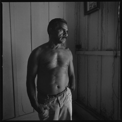 Lauro Santos a Brazilian farmer who lost his arm when he grabbed an army grenade by mistake during the guerilla times in the early 1970s, killing instantly his brother. Here photographed in his home in Sao Joao do Araguaia. Sao Joao do Araguaia, Brazil, August 2011.