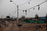 Shoes hang from electricity cables in the sector of Puente Alto. They are placed by gangs to mark their territory and show that in that place people have been assaulted