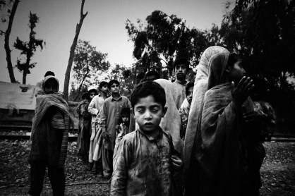 Pakistan, NWFP, June 2009: Mardan disrict, Malakan Road; displaced children waiting for a food distribution made by a local NGO. These people was not accepted in the official camps, So they live without any official and governamental assistance.