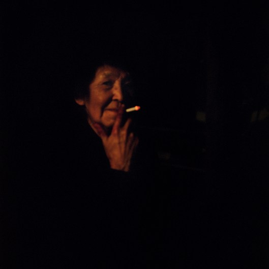 Phillamean Desjarlais takes a cigarette break while cutting moose meat.