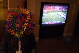 Isabel wears her mask in middle of the football game.