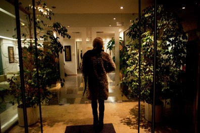 """Athens, Greece 2013 """" Tanya"""" heading inside the hotel where she works as a prostitute every night."""