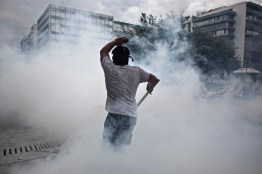 Citizens strongly oppose to austerity measures and keep demonstrating in Athens and in large cities. Police repression and extended use of chemicals causes breathing problems and a suffocating atmosphere in the city.