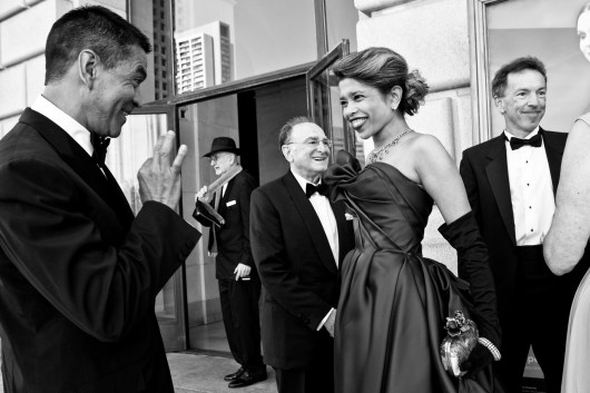Deepa Pakianathan gets a thumbs up of approval on her gown from Daniel Diaz (left) while arriving at the opera house to attend the San Francisco Opera Opening Night gala. Pakianathan, a venture capitalist, is one of a new breed of socialites who mix high-powered careers with their social obligations.
