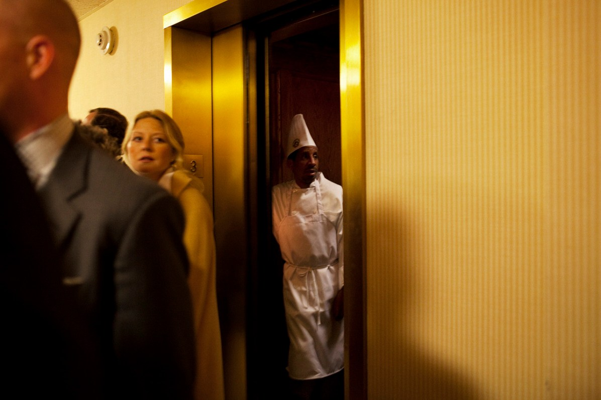 A chef rides the elevator at The Capital Hill Club during a gathering for Freshman Congressman Adam Kinzinger, 32, (Republican, Illinois) with supporters after being sworn in to office at the United States Capital in Washington, DC on Wednesday, January 5, 2011. He will be a member of the 112th Congress, and represents the 11th Congressional District.