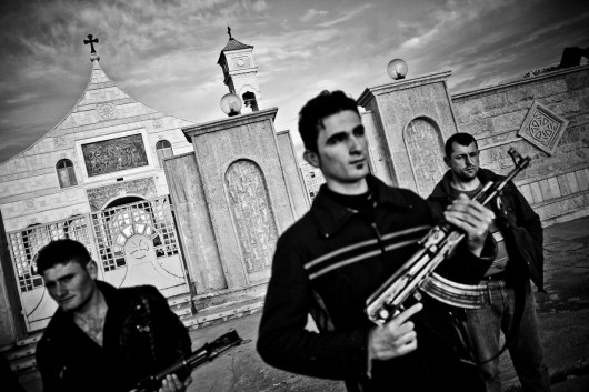 The local christian militia under the command of Father Luis Sako is protecting the church of St. Bernam & Sarah in Qaraqosh. Father Luis Sako, after the 2003 US Invasion of Iraq, invented and put into life the idea of a christian militiain Qaraqosh, protecting the city against muslim extremists. Since then, the armed and 1200 men strong militia is under his ultimate command, providing security for the city borders as they control the checkpoints around Qaraqosh as well as the churches.