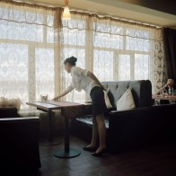 Mongolia, Gobi, Tsogttsestiie sum, 2012 A waitress is working at the Broadway restaurant, the only restaurant for foreigners in the sum