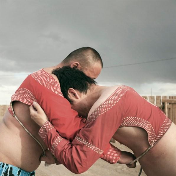 Mongolia, Gobi, Tsogttsestiie sum, 2012 Saikhana is wrestling with one of his friends