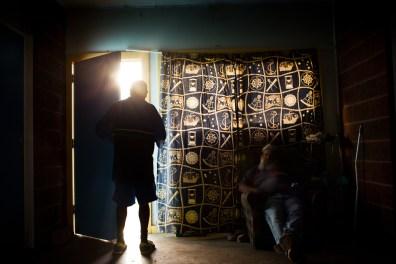 Barkindji men drink inside a neighbors house during the heat of the day. David Maurice Smith/Oculi.