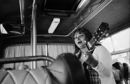 Woman playing chilenian songwriter Violeta Parra's songs in a regional bus in the city of Temuco.