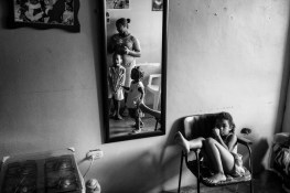 Yohanna, spends time with her children inside their home on the 17th floor of the tower.