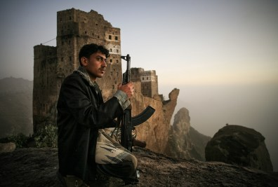 Shugruf, Yemen: A young man is guarding the khat fields in the valley below. © Matjaz Krivic