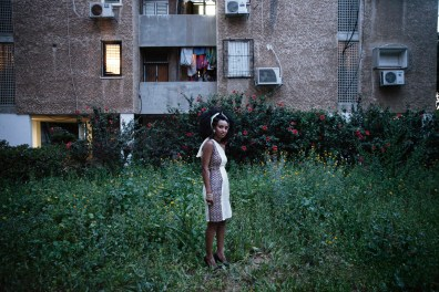 """Samravit Solomon, a 24 year-old Eritrean asylum-seeker leaving a birth-day party in Tel Aviv. """"Language is power, because as soon as I learned Hebrew, I was able to speak for myself, my family and the Eritrean community in Tel Aviv. I volunteer as a translator for Eritreans that don't speak Hebrew. I go with them to doctors appointments, court dates and really anywhere they are interacting with Israelis."""""""