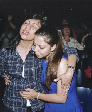 A mother and her daughter at an evangelical church. (Dominic Bracco II / Prime for Pulitzer Center on Crisis Reporting)