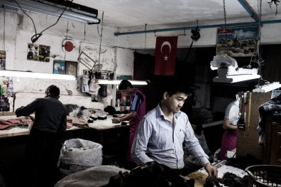 Shamzur Rahmat, 17, and other Afghan refugees work in a underground textile factory in Istanbul, Turkey, May 2, 2012. All the workers here are Afghan refugees. They make 70 Turkish Lira (40 USD) a week working more than 60 hours. Many of them safe money for traffickers to take them to Greece over the river Evros. The traffickers take between 600 and 2000 US Dollars. The land border between the two countries has become the main illegal entry point for refugees going to Europe according to Frontex, the European Union's border policing agency. In 2011 that amounted to more than 55,000 people who were detected, a 17 percent rise from the year before.