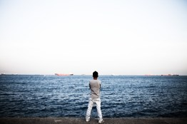 Mustafa, 17, a refugee from Afghanistan looks over the Marmara Sea in Istanbul, Turkey, May 2, 2012. After a failed attempt to get from Athens, he returned without money and nothing more than his clothes to Istanbul. He and his friend Ali made it over the border, crossing the river Evros, but then ran out of money and could not find a way to travel from the border to Athens. Shivering, they have been waiting in this seaside park for hours to get picked up by a friend. The land border between the two countries has become the main illegal entry point for refugees going to Europe according to Frontex, the European Union's border policing agency. In 2011 that amounted to more than 55,000 people who were detected, a 17 percent rise from the year before.