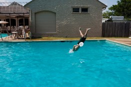 A young man dives into the pool at the Greenwood Country Club in Greenwood, Mississippi on May 19, 2012.