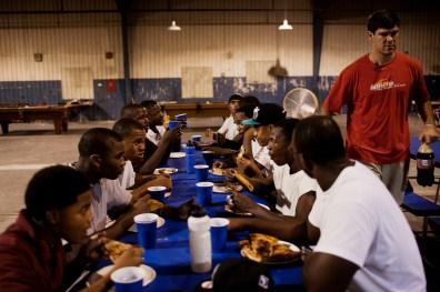 T.Mac Howard (far right) serves pizza to young men from south Greenwood in a building donated to Delta Street Ministries in Greenwood, Mississippi on September 29, 2011. Mr. Howard started a school for at-risk young men in 2012.