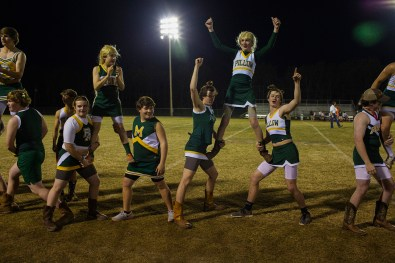 Boys dressed as cheerleaders perform a routine at the Powder Puff Football Game at Pillow Academy, the private school in Greenwood, Mississippi on March 31, 2014. For this role-swapping events the boys don cheerleader costumes, learn dances and the girls engage in a game of touch football while the parents sit back and enjoy the show.
