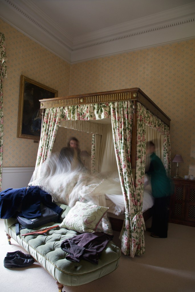 G.B. ENGLAND. Holkham Estate. North Norfolk. Making up one of the guests' bedrooms. The rooms are as big as my own house.