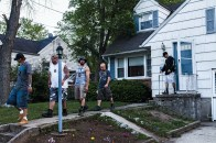 Bounty hunters leave the house of a fugitiveÕs relative in Baltimore County, Maryland, 2013.
