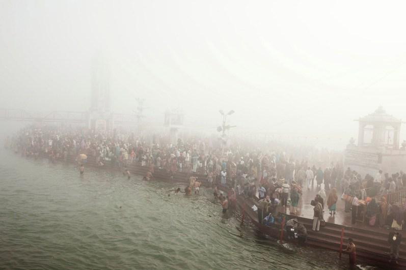 Hindu devotees bathe in the Ganges during the Kumbh Mela, India 2010.