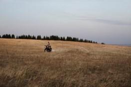 A young boy having fun while is running with the bike of his father in the countryside around the village. (ITA) Un giovane attraversa i campi con la moto di suo padre nelle campagne attorno al villaggio.