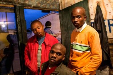 Akhona godlo, Lwazi Pakade and Bubele Moodie in a barbershop in Langa township. 2013